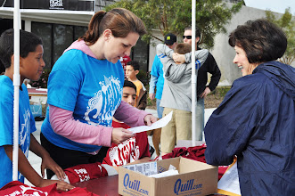 Photo: A preregistered walker receives her shirt.