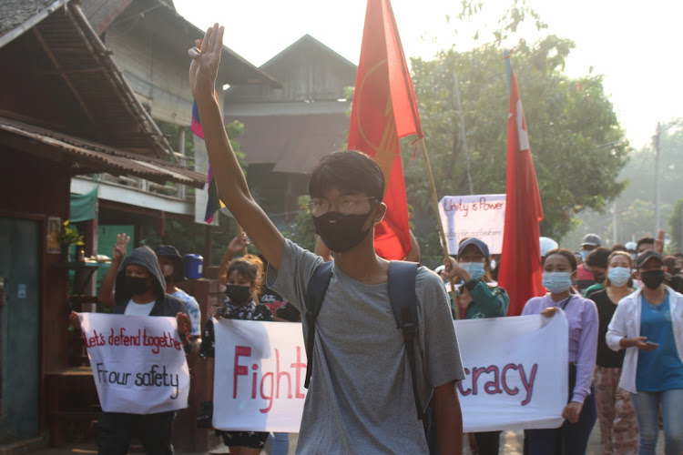 Demonstrator displays the three-finger salute as university students and LGBT community members march against the ongoing coup in Dawei, Myanmar March 25 2021. Picture: DAWEI WATCH