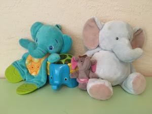 Four elephant toys
