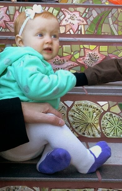 Photo: Ava near the family tile on the Hidden Garden Steps (16th Avenue, between Kirkham and Lawton streets in San Francisco's Inner Sunset District) during the opening celebration (Saturday, December 7, 2013)  For more information about the Steps, please visit our website (http://hiddengardensteps.org), view links about the project from our Scoopit! site (http://www.scoop.it/t/hidden-garden-steps), or follow our social media presence on Twitter (https://twitter.com/GardenSteps), Facebook (https://www.facebook.com/pages/Hidden-Garden-Steps/288064457924739) and many others.
