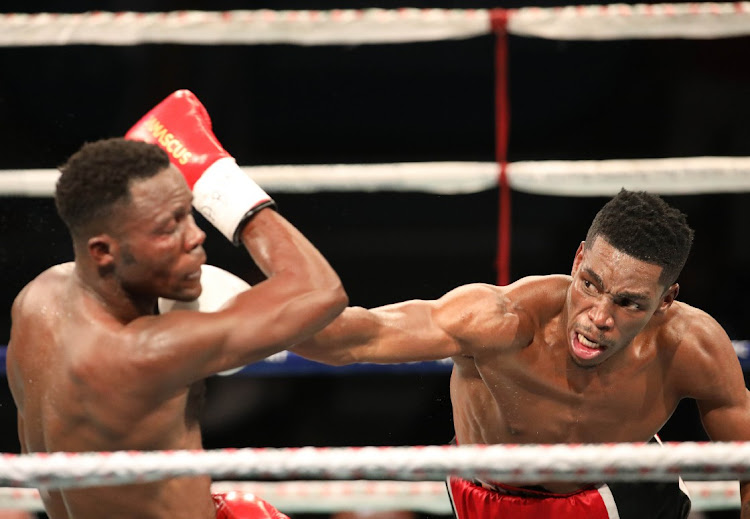 Thulani Mbenge lands a punch Kuvesa Katembo of the DRC during the ABU Welterweight title at Klipspruit Sports Centre,Soweto.