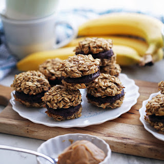 Banana Oatmeal Sandwich Cookies with Peanut Butter Cocoa Filling.