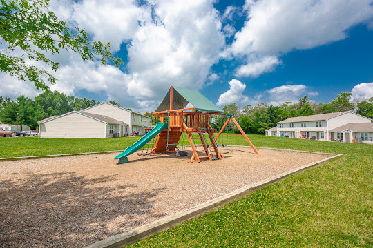 Bethel Park playground surrounded by apartment buildings