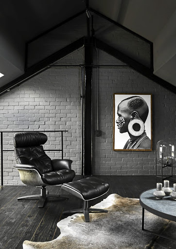 An Eames chair invites you to sit and relax in the top-floor chill area.