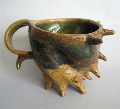 Photo: beverage defender mug #3 - halved & quartered
