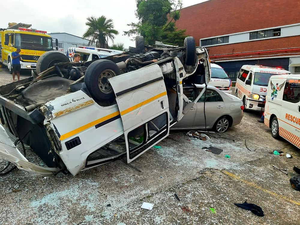 WATCH | Shocking moment fully laden Durban taxi crashes into parking lot - TimesLIVE