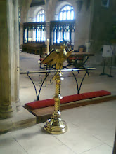 Photo: A golden eagle lectern and the space of the choir and altar area.