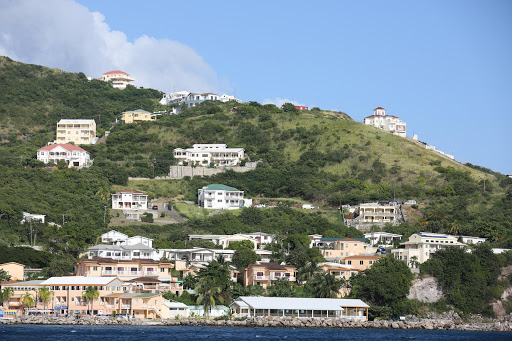 st-kitts-houses.jpg - Houses line the coastline of St. Kitts.