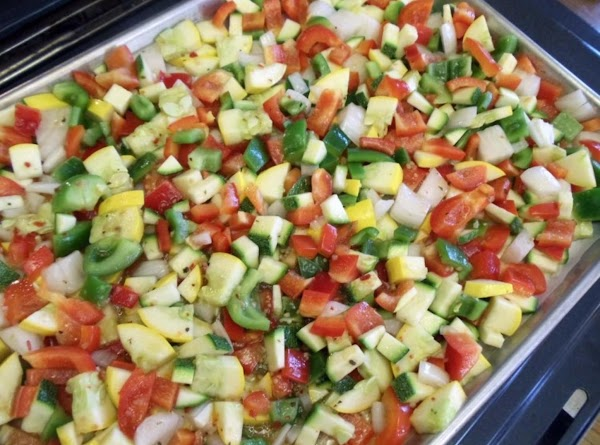 Preheat oven to 450 F. Cut squash, peppers, and onion into bit size pieces....