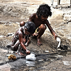 Poor Children Taking Bath in Dirty Water by Umair Nayab - Babies & Children Children Candids ( children portrait, bath, poor, children, children candids,  )