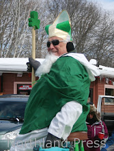 Photo: Tony Maucieri, Sr. gave the judges a bog smile as he passed through Crosslake mid town - photo by Paul Boblett