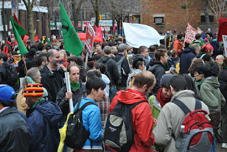 Photo: A large crowd gathers at Queen Street West and Jameson Avenue at the beginning of this year's May Day.