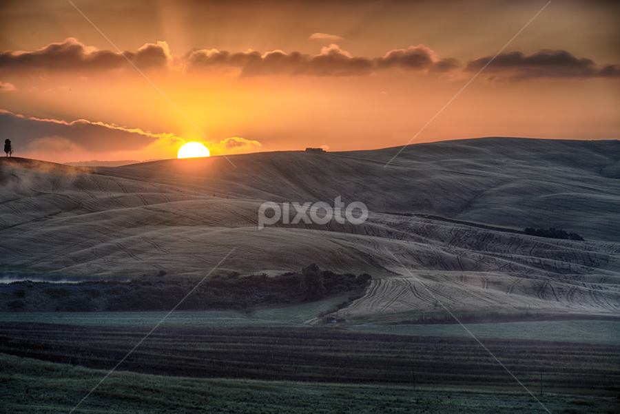 Sunrise over the Crete Senesi by Maurizio Martini - Landscapes Sunsets & Sunrises ( countryside, tuscany, freedom, rapolano, sky, shadow, light, hill, agriculture, white, tourism, quiet, siena, plough, country, touristic, silence, crest, shade, truffles, clay, famous, erosion, arid, plow, crete, valley, landscape, hillside, lunar, grey, italy, clouds, desert, pienza, scenic, senesi, agricultural, montepulciano, acciona, field, mattaione, pattern, blue, terme, undulated, asciano, brown, sunrise, tuscan,  )