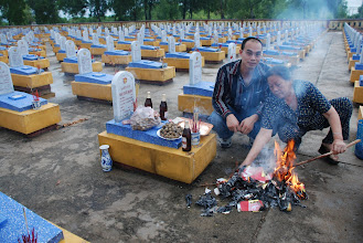Photo: Mom is burning the offerings. That's a lot of money, supposedly, I hope he and his friends can party for a while...