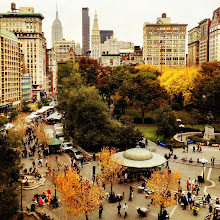 """Photo: """"Holding on...""""  On cloudy days in autumn, the trees stick out from the ground below like paintbrushes heavy with memories of the sun's embrace.  And the city, weary in preparation of shorter days, clamors to hold onto every last bit of color and light. —-  I love this view of Union Square Park looking towards the Empire State Building and the beautiful skyscrapers in midtown Manhattan. It's particularly gorgeous in the autumn when the trees change color before descending gracefully to the ground.    New York Photography: Autumn as seen above Union Square.    You can view this post along with information on where to purchase prints of this image if you wish at my site here:  http://nythroughthelens.com/post/35638215945/autumn-new-york-city-above-union-square-on  --  Tags: #photography  #nyc  #newyorkcity  #newyorkcityphotography  #autumn  #autumnnewyork  #autumnnyc  #treetuesday  #trees  #autumnphotography  #unionsquarenyc  #cityphotography  #cityautumn  #fall  #fallcolors  #fallnyc  #nycautumn"""