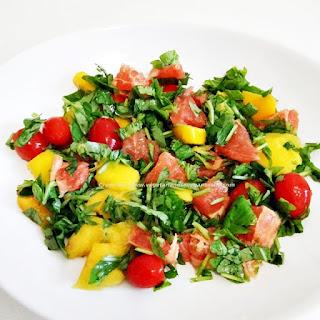Arugula Salad with cherry tomato, grapefruit and mango