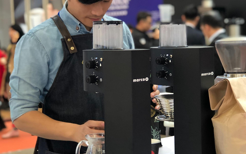 barista using marco coffee machine