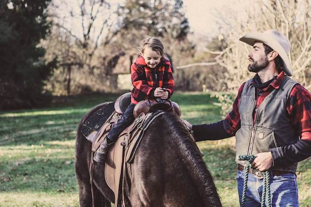 Girl riding a horse; family activities in Texas