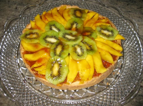 Let cool. Spread 3/4 cup apricot preserves on the surface of the baked tart...