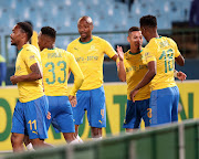 Mamelodi Sundowns start winger Themba Zwane (R) celebrates a goal with teammates during the 2-0 Absa Premiership win over Lamontville Golden Arrows at Loftus on May 7 2019.