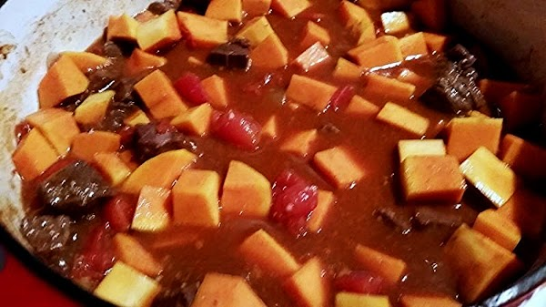 Stir in the broth and tomatoes and bring to a boil. Continue cooking for...