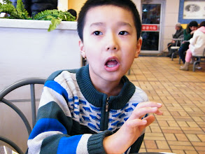 Photo: family biweekly dinning out in KFC. the son, warrenzh 朱楚甲 visit his dad, benzrad's temporary lodge in QRRS dorms. on way they ate KFC. this month benzrad's salary likely increase ¥200 to ¥2200, so we had a rich KFC. here warrenzh ate KFC breakfast.