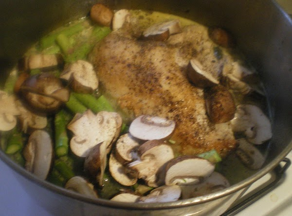 Simmer on medium-low for 10 minutes.  Add mushrooms and asparagus and continue to...