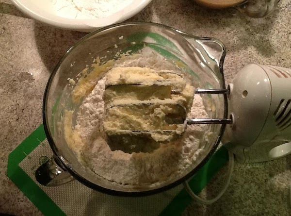 Add vinegar to milk and let set for about a minute. Begin to add...