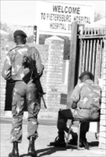 FILE PHOTO: Police at Polokwane Hospital in Limpopo during a previous incident when staff members protested over bad working conditions. Pic. Elijar Mushiana. 10/02/2010. © Sowetan.