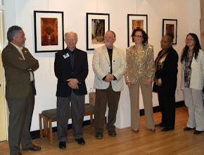 Photo: At the Arts Barn in Gaithersburg, December 2009. Michael Sesma, Phil Brown, Peter Manzelli (photographer), Natalya Parris (gallery curator), Zandra Chestnut (photographer), and Irene Abdou (photographer) at opening reception. [0912]