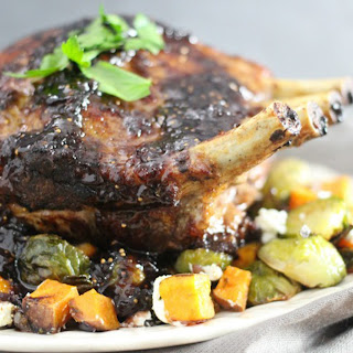 Fig Glazed Rack of Pork with Roasted Brussels Sprouts and Sweet Potatoes.