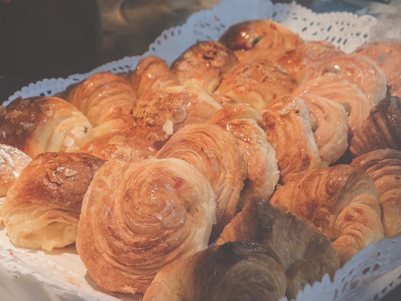 A closeup of the sweet croissants being sold at one vendor's stall