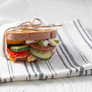 Garden Sandwich with Hummus, Vegetables, and Feta.