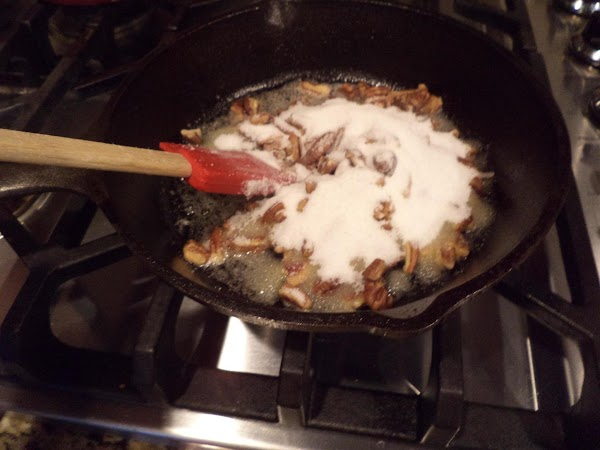 Add the chopped pecans and sugar. Stir until coated. Keep your eye on this...