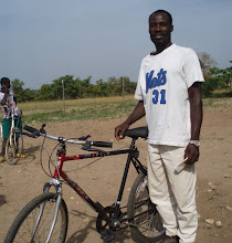 Photo: Ahmed is from the village Dupari. He will use his bike to go to market at Bulenga, Chaggo and Wa, which is 35km away to buy things that he can't get in Dupari. He can sell these items to his neighbors who don't have time to walk to the bigger towns. Owning a bike will make life for Ahmed much easier, so he can be more productive and increase his income.