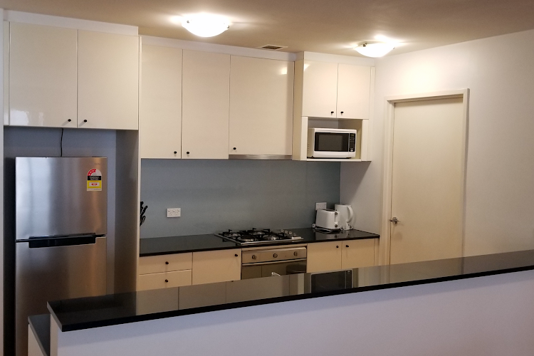 Fully equipped kitchen at Mid-Town Apartments, Sydney CBD