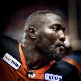 Defensive Tackle by Garry Dosa - People Portraits of Men ( orange, sports, teams, players, black, indoors, cfl, stadium, football, portrait, people )