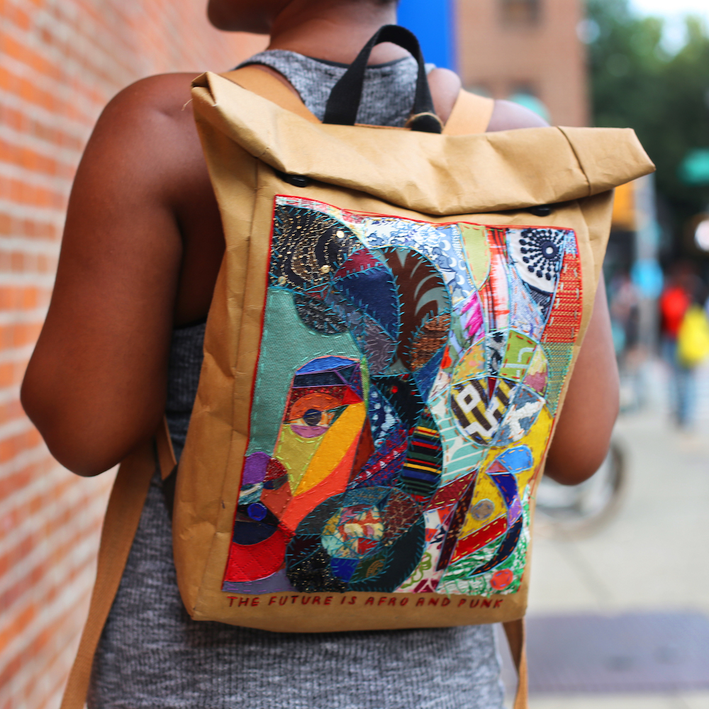 A Classic Schooled by Paper DrawBag with sewn-in artwork by Brooklyn-based artist Zharia Shinn @zhariart.