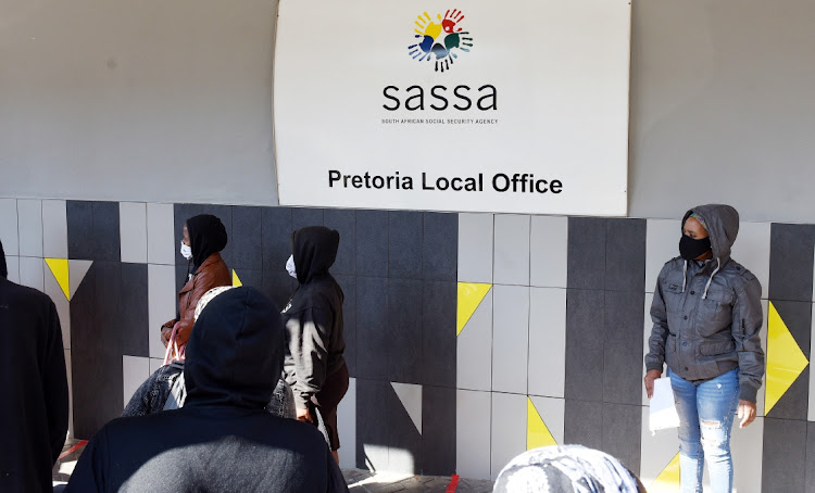 Pretoria residents queue to apply for child support grants in the SA Social Security Agency head office during the Covid19- lockdown. Picture: FREDDY MAVUNDA