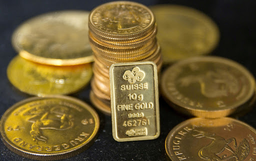 Optimism about trade talks and uptick in dollar weigh gold down