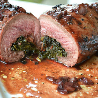 Kale & Bacon Stuffed Flank Steak with a Red Wine Reduction.