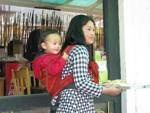 Photo: A waitress at a cafeteria in Thimphu.