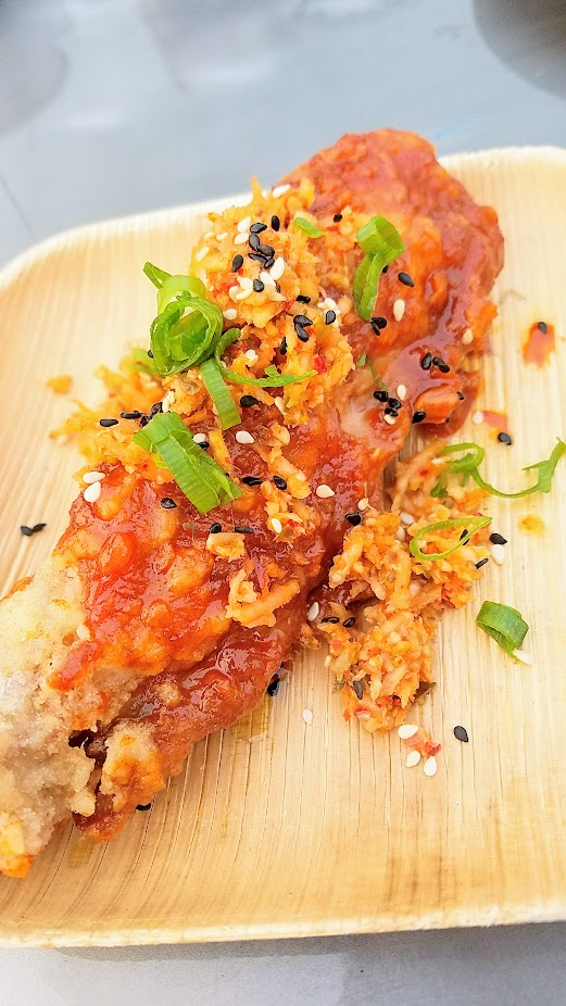 Review of Feast PDX Smoked 2017, Gregory Gourdet of Departure offered Crispy Turkey Wing, Sweet Korean Chilli Glaze and also Duck Fat Ice Cream, Burnt Coconut, Marionerry, Buckwheat Crumble