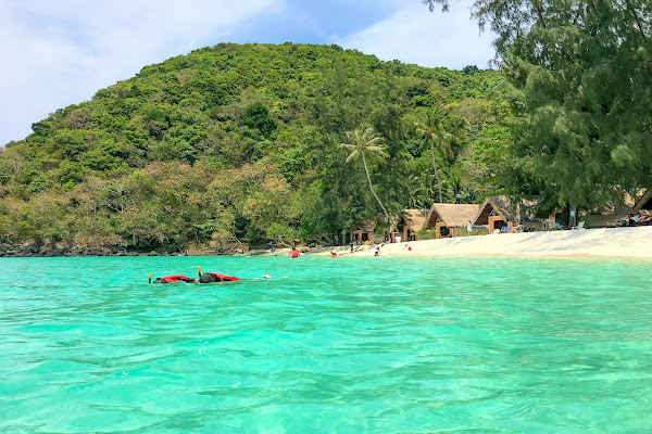 Swim over the coral reef in Mai Ngam Bay