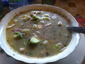"""Photo: On another cold wet day we found this little restaurant and soup dish after seeking alpacas in a small down. The hot potato, veggie and meat soup was just what we needed to warm up. Brian liked the flavor of the brown spice that came with it. Asking the restaurant waitress in broken Spanish what it was... we were wondering why she smiled and hesitated... """"sangre de cerdo"""" was her reply. Pigs Blood!   Good thing Brian ate it BEFORE asking!"""