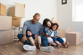 Diverse family moving in