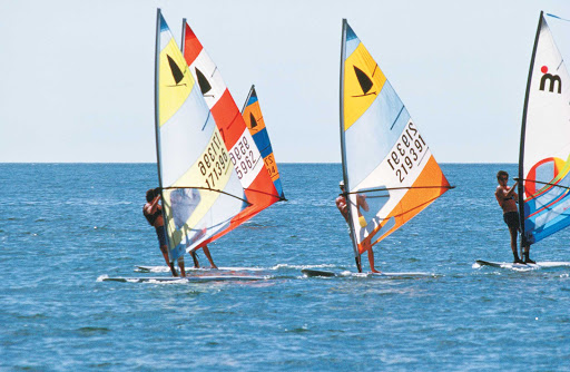 Windsurfing (sometimes called sailboarding) in Florida.