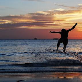 sunset session by Dan Baciu - People Fine Art ( skimboard, pwcsilhouettemotion, kitesurfing, white, skimboarding, kitesurf, sea, beach, island, sunset, boracay, phillipines, surf, boy, , silhouette )