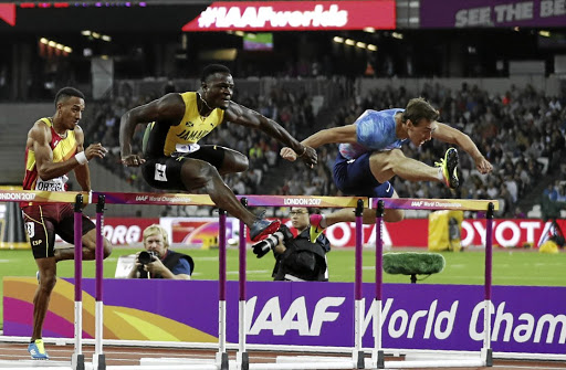 Omar McLeod of Jamaica on his way to winning gold in the men's 110m hurdles at the athletics world championships in London on August 7 2017. Picture: REUTERS