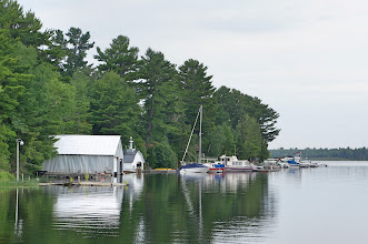 "Photo: We set out on Lac La Belle (French: ""Lake Beautiful""), past a series of boat houses."